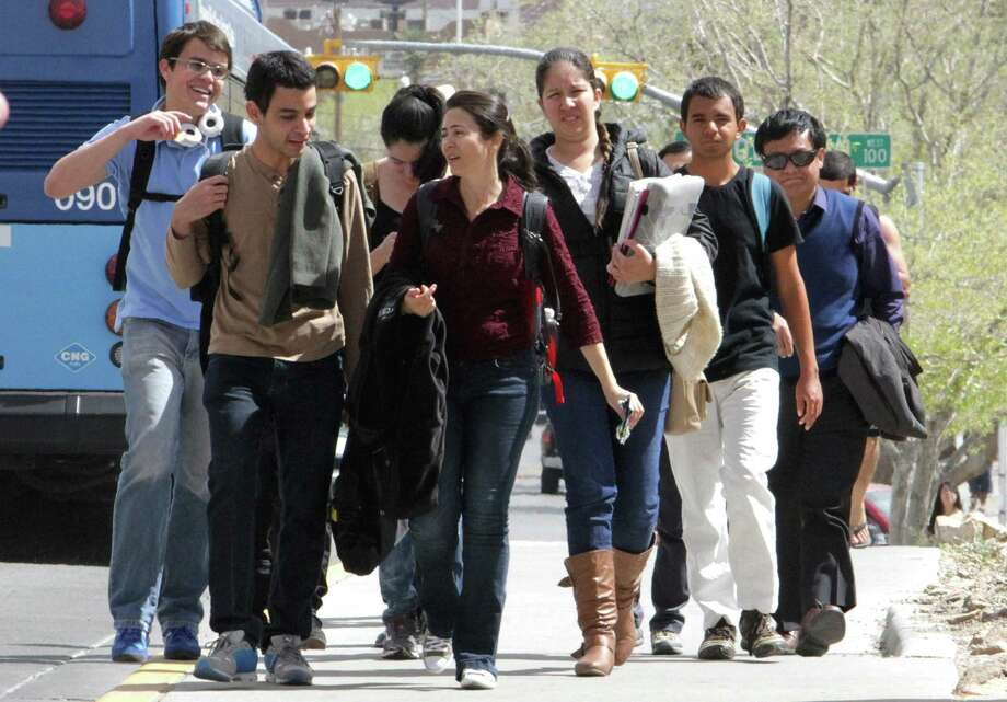 Students leave the UTEP campus in El Paso, known for its high Hispanic enrollment. Goals of academic success must begin early for Latino students, fostered by encouragement from their parents. Photo: Rudy Gutierrez /Associated Press / El Paso Times