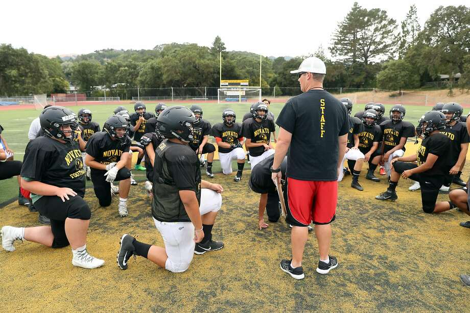 Kevin Keenan, head football coach at Novato High School, talks to his players at the start of practice. Novato was a football powerhouse a dozen years ago, but player participation is down. Photo: Scott Strazzante, The Chronicle