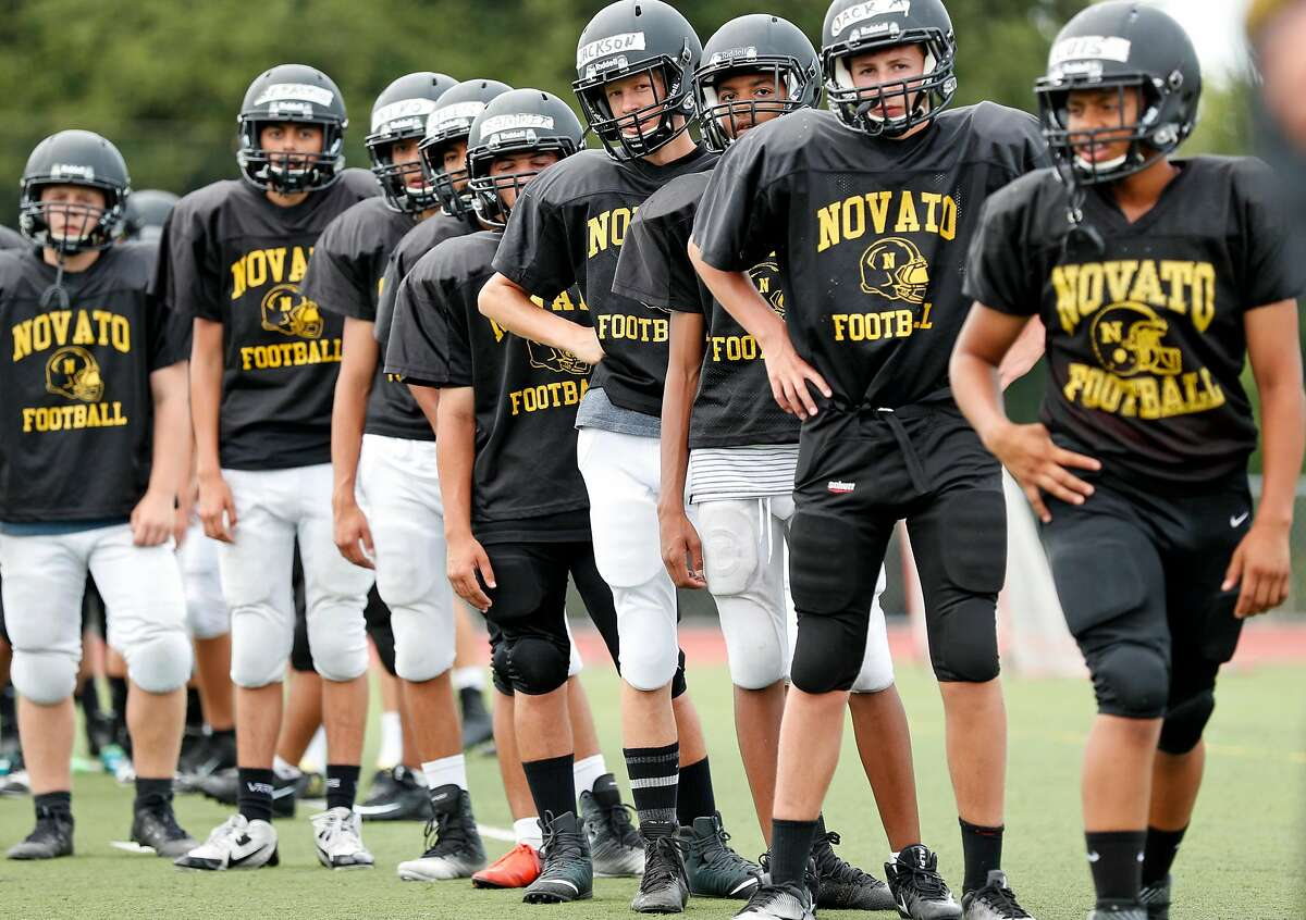 Novato High School football'sJack McMann, (second from the right),Jackson Gremmels (fourth from right) and teammates during practice in Novato, Calif. on Thursday, August 3, 2017.