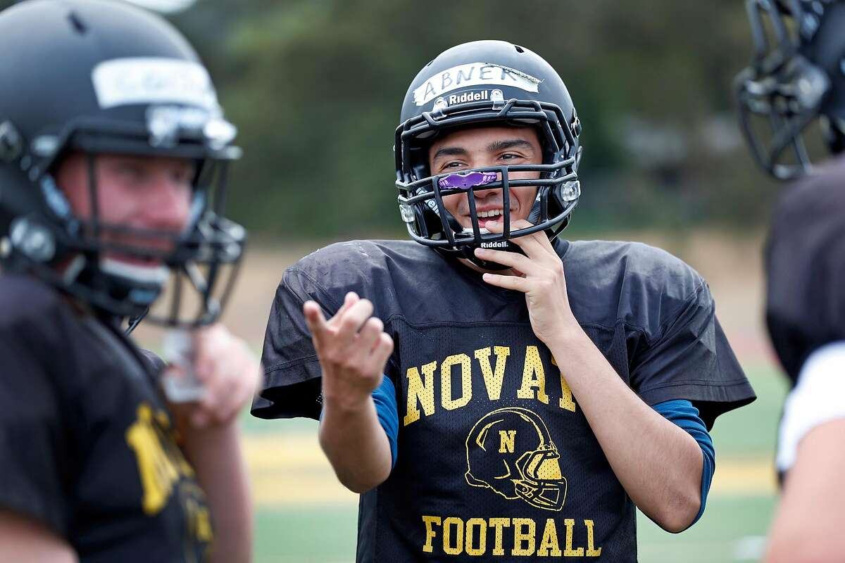 Novato High School football junior Abner Diaz jokes with teammates during practice in Novato, Calif. on Thursday, August 3, 2017.