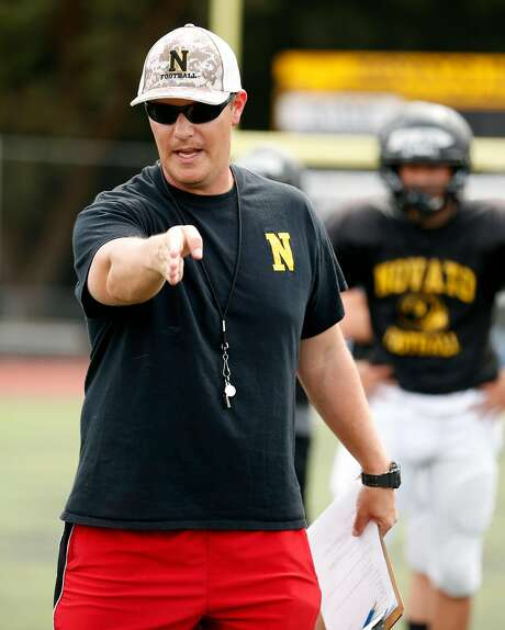 Novato High School head football coach Kevin Keenan instructs his team during practice. Photo: Scott Strazzante, The Chronicle
