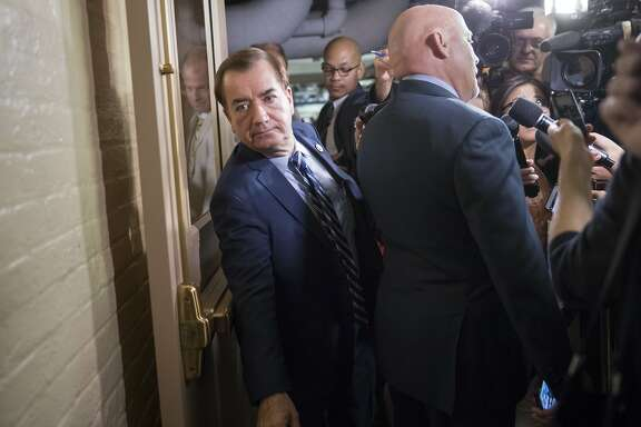 House Foreign Affairs Committee Chairman Rep. Ed Royce, R-Calif., left, squeezes past another lawmaker being interviewed by reporters as he heads to a House Republican Conference meeting on Capitol Hill in Washington, Friday, July 28, 2017. Dealing a serious blow to President Donald Trump's agenda, the Senate early Friday rejected a measure to repeal parts of former President Barack Obama's health care law after a night of high suspense in the U.S. Capitol. (AP Photo/J. Scott Applewhite)