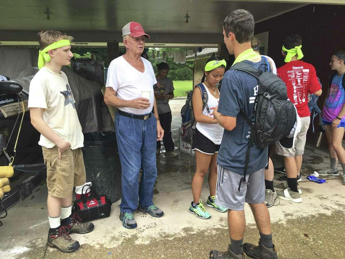 BLH youth volunteers listen to flood stories from Louis Harris of Denham Springs, LA