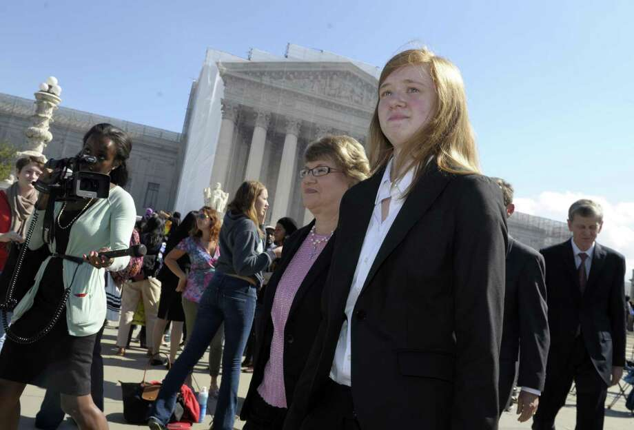 Abigail Fisher, right, who sued the University of Texas, walks outside the Supreme Court in Washington Oct. 10, 2012. The court upheld the school's use of limited race-based admission policies, but the Trump administration is reportedly targeting them anyway. Photo: Susan Walsh /AP / Associated Press
