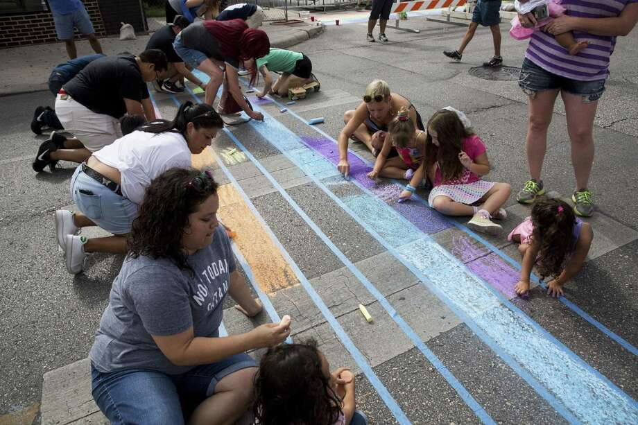 Volunteers use chalk to create rainbow crosswalks to honor the LGBT community at Evergreen and Main streets. A reader condemns a proposal by Councilman Robert Treviño to recognize the community with a permanent rainbow on Main Avenue. Photo: Carolyn Van Houten /San Antonio Express-News / 2017 San Antonio Express-News