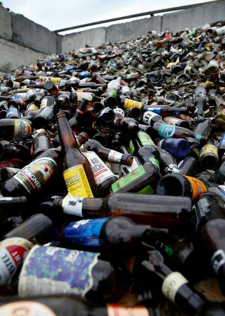 A mountain of brown beer bottles are piled high at the Our Planet Recycling collection center on Bayshore Boulevard in San Francisco, Calif. on Thursday, Aug. 3, 2017. Independent recycling centers are struggling to stay open saying the state subsidies aren't enough to keep them in business. Photo: Paul Chinn, The Chronicle