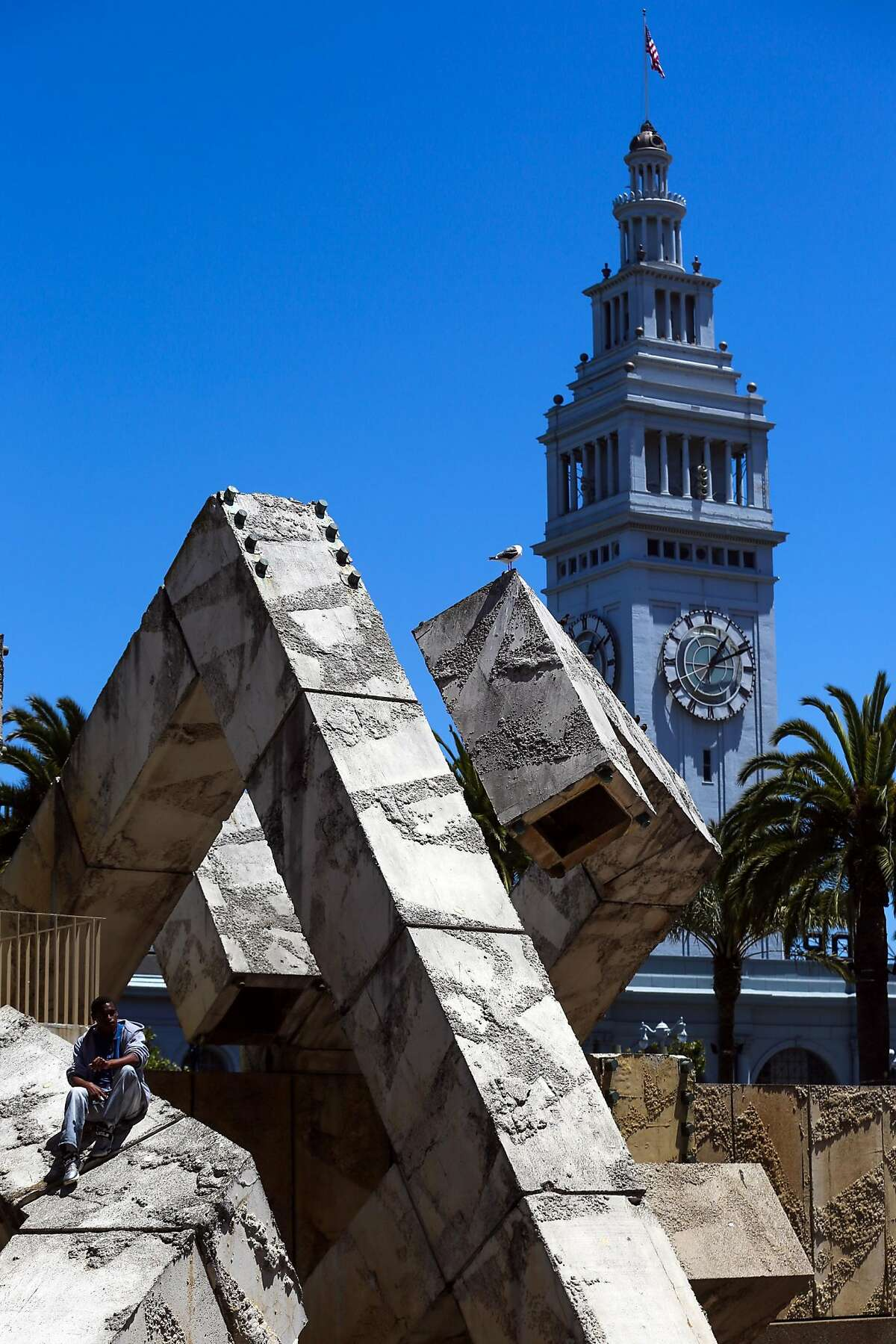 Stephan Carter-Mason hangs out in Justin Herman Plaza in San Francisco, Calif., on Wednesday, July 12, 2017.