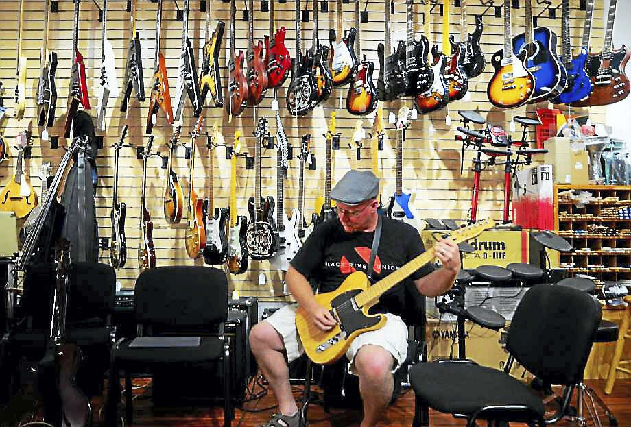 Roger Long, of Derby, takes part in an open jam session held each Tuesday night at Banko's Music store in Ansonia, Conn., on Tuesday August 1, 2017. Owner Joe Shapiro bought the music store which has been in downtown Ansonia for the past 62 years. He has remodeled portions, built a stage for a Tuesday night live microphone jam session, renovated the instruction rooms and has really cleaned the place up Photo: Christian Abraham / Hearst Connecticut Media
