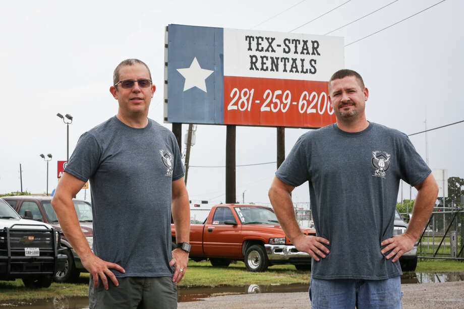 "Magnolia Diesel Performance owners Chris Blair, right, and Charles ""Chuck"" Bondurant, left, are pictured in front of a billboard on the property of their business Friday, Aug. 4, 2017. Photo: Michael Minasi, Staff Photographer / © 2017 Houston Chronicle"