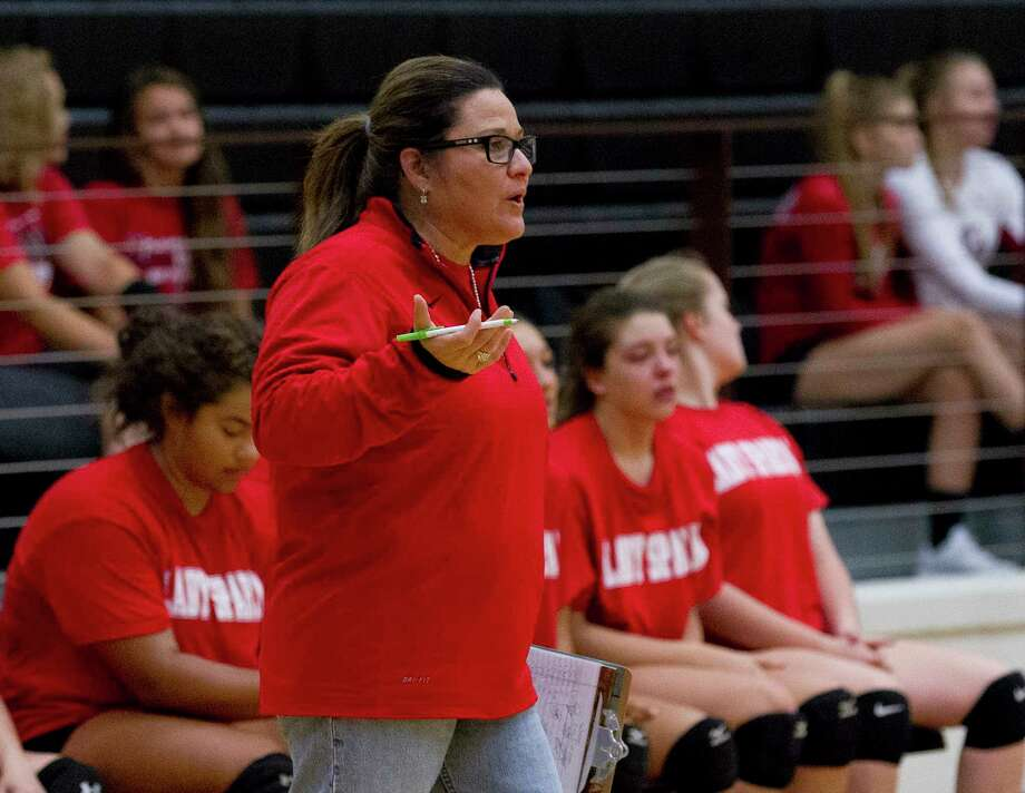 Porter head coach Doris Elizondo instructs player during a high school volleyball scrimmage at Porter High School, Friday, Aug. 4, 2017, in Porter. Photo: Jason Fochtman, Staff Photographer / © 2017 Houston Chronicle
