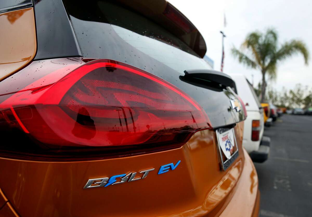 A new Bolt EV all-electric car is parked in the lot at a Chevrolet dealership in Fremont, Calif. on Friday, Aug. 4, 2017. Proposed state legislation may provide instant rebates to boost sales of plug-in vehicles.