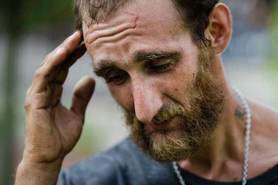 In this Monday, July 24, 2017 photo, Steven Kemp, who is addicted to heroin and is homeless, speaks with The Associated Press after meeting with a Philly Restart representative for help to obtain an identification card in Philadelphia. As an opioid epidemic ravages the nation, small but vulnerable populations of homeless people who are seeking respite from their addictions are sometimes turned away from the country's already threadbare system of drug treatment centers because they do not have valid photo identification (AP Photo/Matt Rourke) Photo: Matt Rourke, STF / Copyright 2017 The Associated Press. All rights reserved.