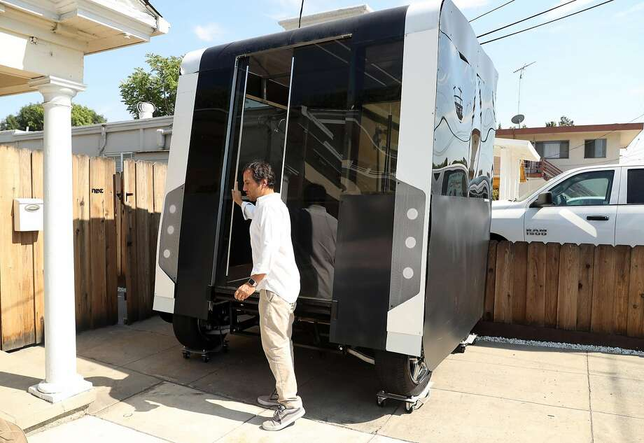 Next Future Transportation's Emmanuele Spera shows a self-driving pod vehicle prototype that is part of the modular mass-transportation system the startup envisions for moving groups of people around. Photo: Scott Strazzante, The Chronicle