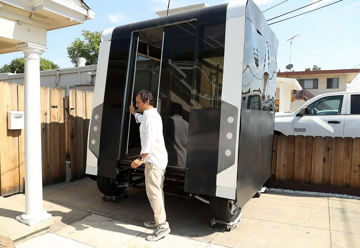 Next Future Transportation's Emmanuele Spera with his self-driving transportation system pod prototype at the business in San Jose, Calif. on Wednesday, August 2, 2017.