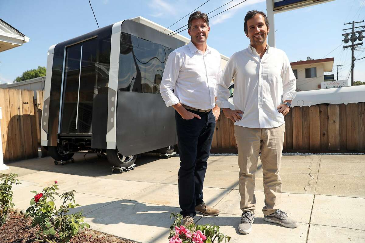Next Future Transportation's Emmanuele Spera (right) and Sven Hackmann with Spera's self-driving transportation system pod prototype at the business in San Jose, Calif. on Wednesday, August 2, 2017.