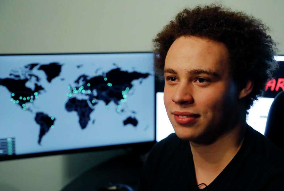 FILE - This Monday, May 15, 2017, file photo shows British IT expert Marcus Hutchins, branded a hero for slowing down the WannaCry global cyberattack, during an interview in Ilfracombe, England. On Friday, Aug. 4, 2017, a computer law expert described the evidence so far presented to justify Hutchins' arrest in Las Vegas earlier in the week for allegedly creating and selling malicious banking software, as being problematic. (AP Photo/Frank Augstein, File) Photo: Frank Augstein, STF / Copyright 2017 The Associated Press. All rights reserved.