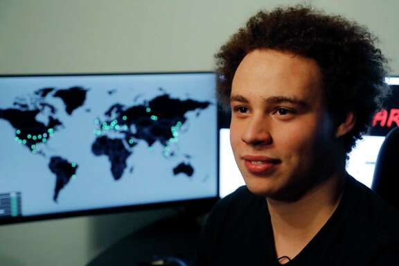 FILE - This Monday, May 15, 2017, file photo shows British IT expert Marcus Hutchins, branded a hero for slowing down the WannaCry global cyberattack, during an interview in Ilfracombe, England. On Friday, Aug. 4, 2017, a computer law expert described the evidence so far presented to justify Hutchins' arrest in Las Vegas earlier in the week for allegedly creating and selling malicious banking software, as being problematic. (AP Photo/Frank Augstein, File)