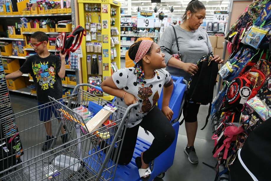 Lavinia Johnson -- with her children 6th grader Micah Blanks, 11, and 4th grader Brooklyn Banks, 10 -- shop for back to school supplies on Tuesday July 25, 2017 at Walmart in Chicago, Ill. (Nuccio DiNuzzo/Chicago Tribune/TNS) Photo: Nuccio DiNuzzo, TNS