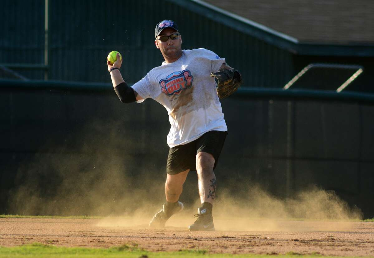 Montgomery County Sheriff's Office shortstop Daniel Pena makes a play against a Woodlands Fire Department hitter during the