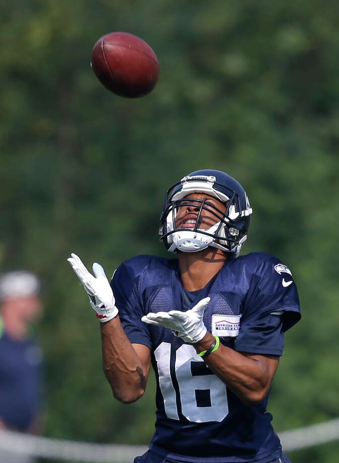 Seattle Seahawks' Tyler Lockett reaches to catch a ball during an NFL football training camp Friday, Aug. 4, 2017, in Renton, Wash. (AP Photo/Elaine Thompson) Photo: Elaine Thompson/AP