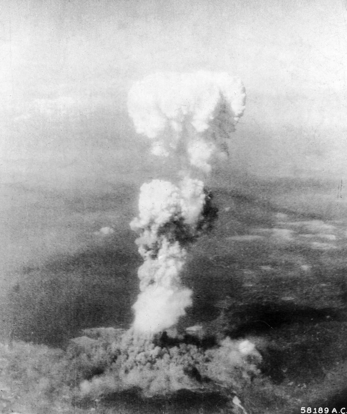 Aerial view of the mushroom cloud of smoke as it billows 20,000 ft. in the air, following the United States Air Force's detonation of an atomic bomb over the city of Hiroshima, Japan, August 6, 1945. (Photo by Time Life Pictures/US Army Air Force/The LIFE Picture Collection/Getty Images)