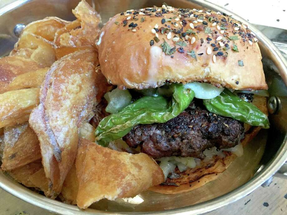 Green chile beef burger at Sternewirth in Hotel Emma at The Pearl. Photo: Paul Stephen / San Antonio Express-News