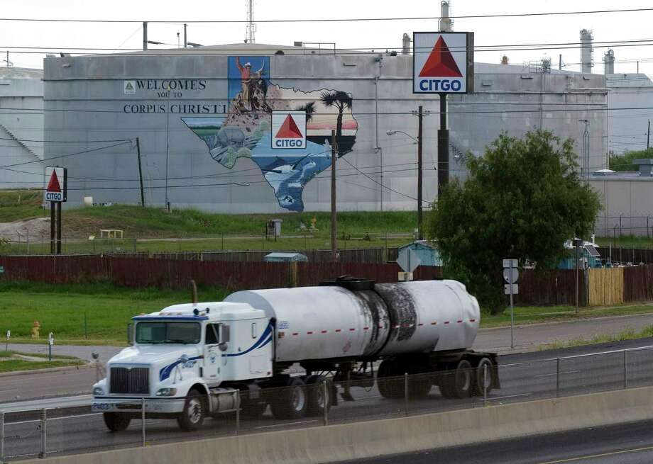 An oil tanker passes storage tanks at the Citgo Refinery in Corpus Christi, Texas, on Thursday, August 10, 2006. Citgo Petroleum Corp., the U.S. refining arm of Venezuela's state oil company, was indicted for benzene emissions at a refinery and for failing to protect migratory birds that became coated in oil at a storage facility. A federal grand jury in Corpus Christi, Texas, issued a 10-count indictment, charging Citgo, its Citgo Refining subsidiary and Philip Vrazel, environmental manager of the company's Corpus Christi East refinery, with criminal violations of the Clean Air Act and the Migratory Bird Treaty Act. Photographer: Eddie Seal/Bloomberg News. Photo: EDDIE SEAL