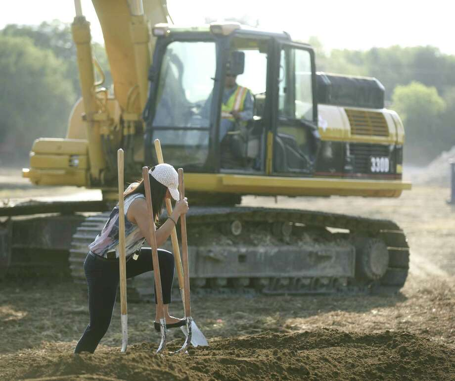 Flor Salas prepares for a groundbreaking ceremony Friday for the Barbara Drive Drainage Phase 1 project. Councilman Roberto Treviño, Transportation & Capital Improvements and community members gathered to break ground on the $6.2 million project designed to assist drainage in the flood-prone area off McCullough Avenue. Photo: Billy Calzada /San Antonio Express-News / San Antonio Express-News