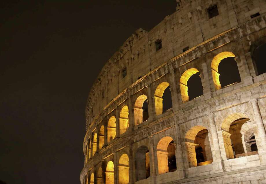 The Colosseum also known as the The Flavian Amphitheatre is illumintated at night  in Rome, Italy. (Photo by Athanasios Gioumpasis/Getty Images). Photo: Thanasios Gioumpasis, Contributor / 2017 Athanasios Gioumpasis