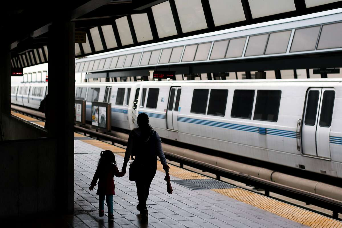 BART riders walk on a platform at the Fruitvale station on Friday, Aug. 4, 2017, in Oakland, Calif.