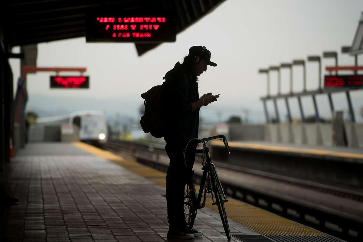 A man waits for a train at BART's Fruitvale station on Friday, Aug. 4, 2017, in Oakland, Calif.