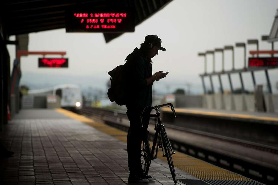 A man waits for a train at BART's Fruitvale station on Friday, Aug. 4, 2017, in Oakland, Calif. Photo: Noah Berger, Special To The Chronicle