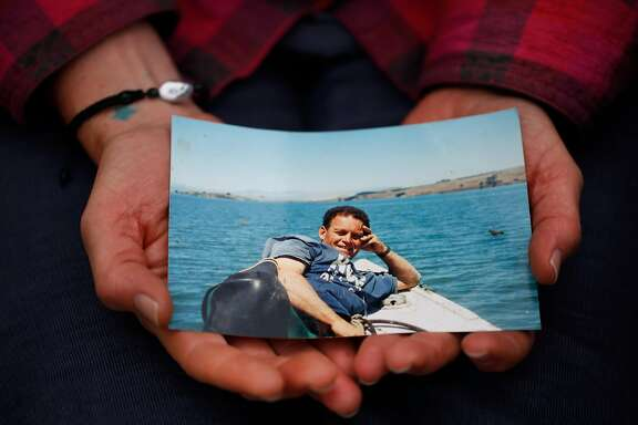Heidi Gregory holds a photograph of her late father Tod Friend July 28, 2017 in Marshall, Calif.