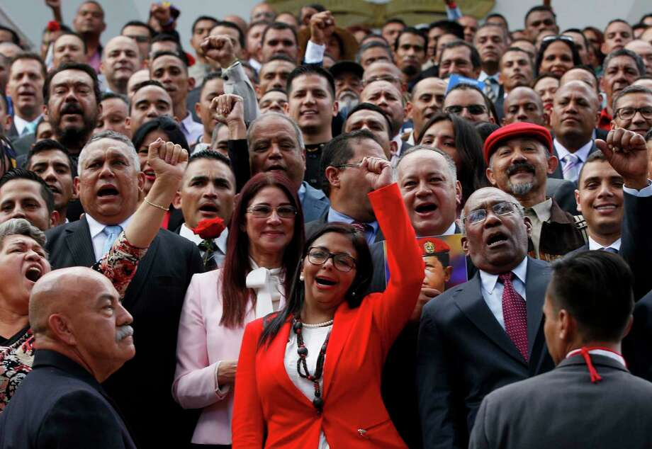 The president of Venezuela's Constituent Assembly Delcy Rodriguez, front and center, leads the newly sworn-in members as they pose for a photo Friday. Photo: Ariana Cubillos, STF / Copyright 2017 The Associated Press. All rights reserved.