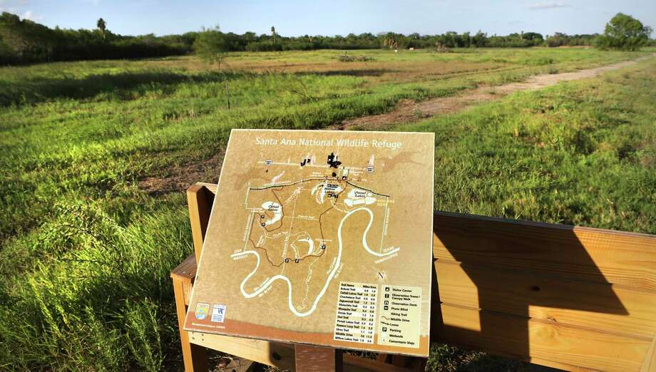 A map shows the trails and lakes in Santa Ana National Wildlife Refuge near Alamo, where engineers have taken soil samples on the levee in preparation to build Trump's Wall. Photo: Bob Owen, Staff / ©2017 San Antonio Express-News