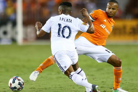 Real Salt Lake forward Joao Plata (10) tries to get past the stretch leg of Houston Dynamo midfielder Ricardo Clark (13) during the first half of the game at BBVA Compass Stadium Wednesday, May 31, 2017, in Houston. ( Godofredo A. Vasquez / Houston Chronicle )