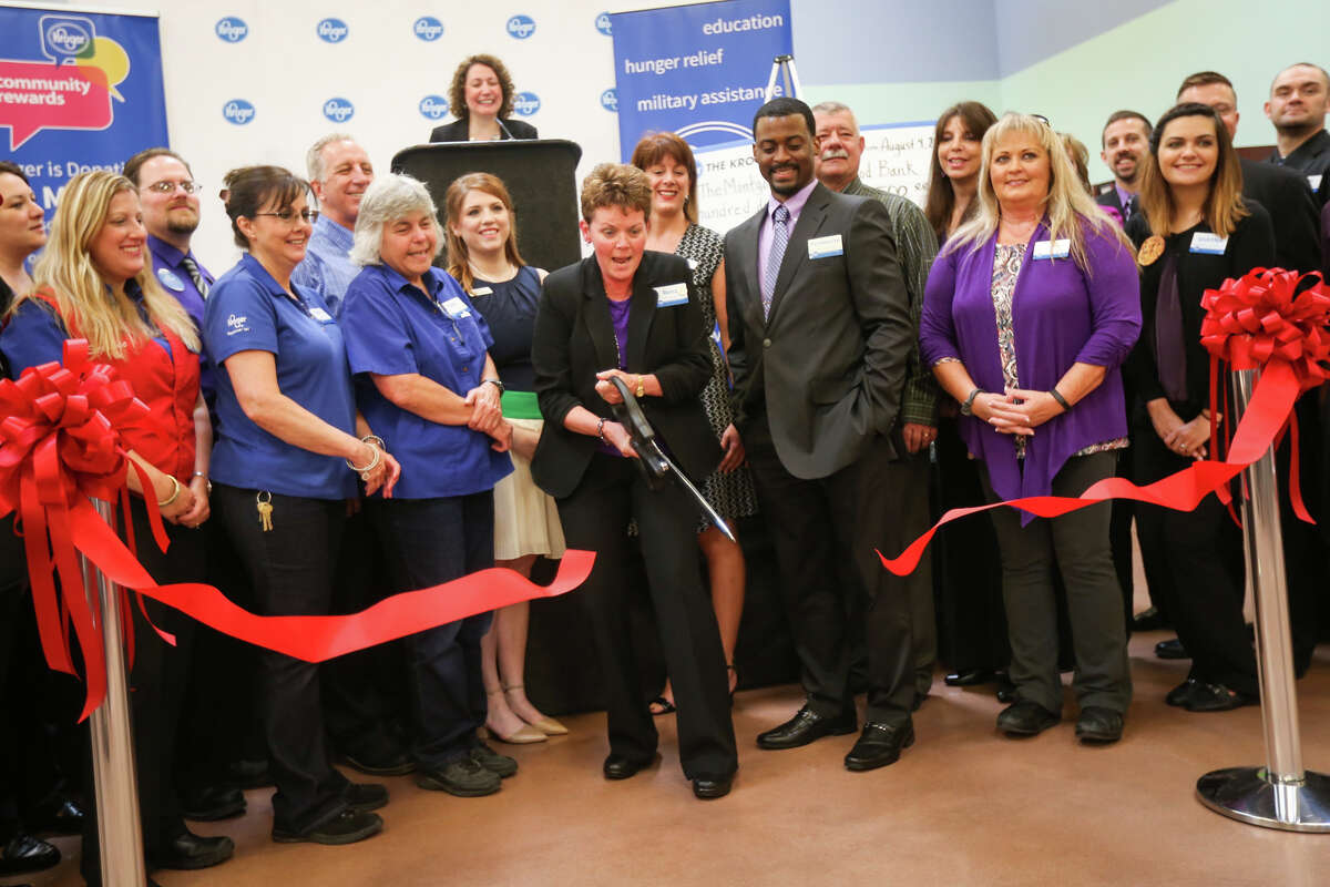 Store Manager Rena Johnston leads her team in the ribbon cutting for the new Kroger Marketplace in Montgomery, open to the public for the first time on Friday, Aug. 4, 2017.
