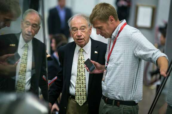 Sen. Chuck Grassley (R-Iowa), left, a member of the Senate Finance Committee, said some Democrats are interesting in pursuing a bipartisan effort to overhaul the nation's tax code.