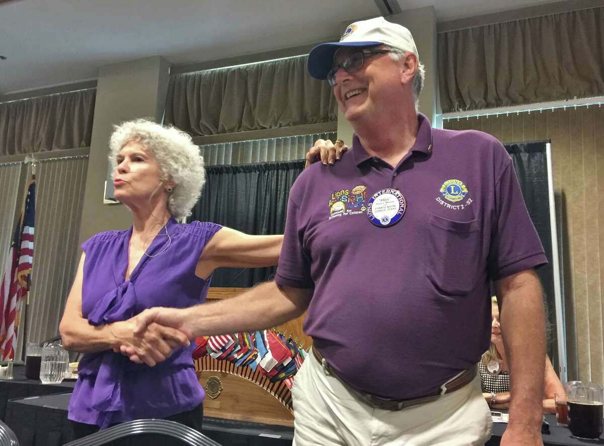 The Conroe Noon Lions Club members were given a body language demonstration on Wednesday by communications specialist, Dr. Linda Talley, left, shown with Lion Paul Moore, right.