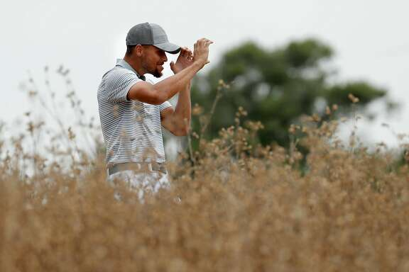 Stephen Curry shows what it is like with all the cameras following him today as he gets set to start his second round of the Ellie Mae Classic golf tournament at TPC Stonebrae in Hayward, Ca., on Fri. August 4, 2017.