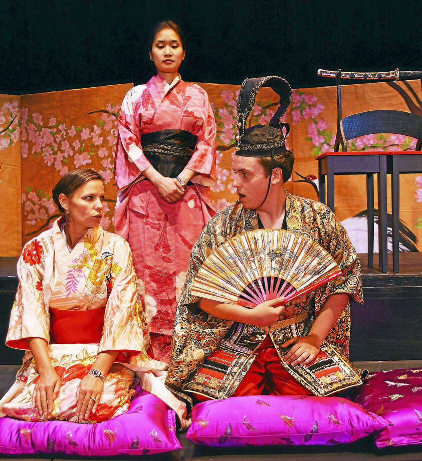 Shannon Kessler Dooley (Madama Butterfly), Evanna Lai (Suzuki), and Zachary Johnson (Prince Yamadori) kneeling, sing and learn the formal use a Japanese fan. Photo: Photo / Opera Theater Of CT