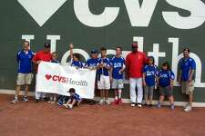 Members of the B.A.M. Electric Challenger Baseball team of the Stamford North Little League celebrate a day at Fenway Park.