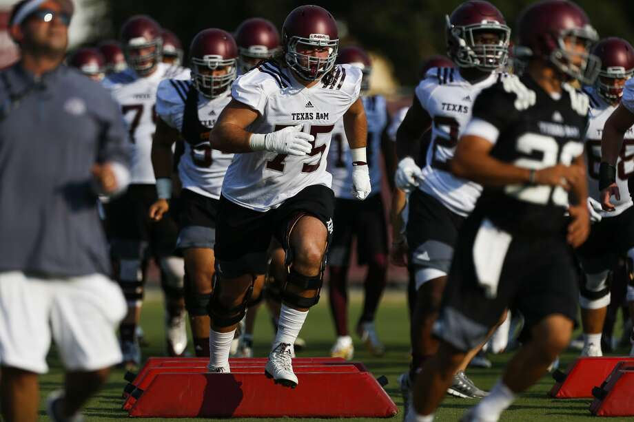 Texas A&M offensive lineman Koda Martin, center, runs through drills during the first day of football practice at the Coolidge Grass Practice Fields Friday, Aug. 4, 2017 in College Station. ( Michael Ciaglo / Houston Chronicle ) Photo: Michael Ciaglo/Houston Chronicle