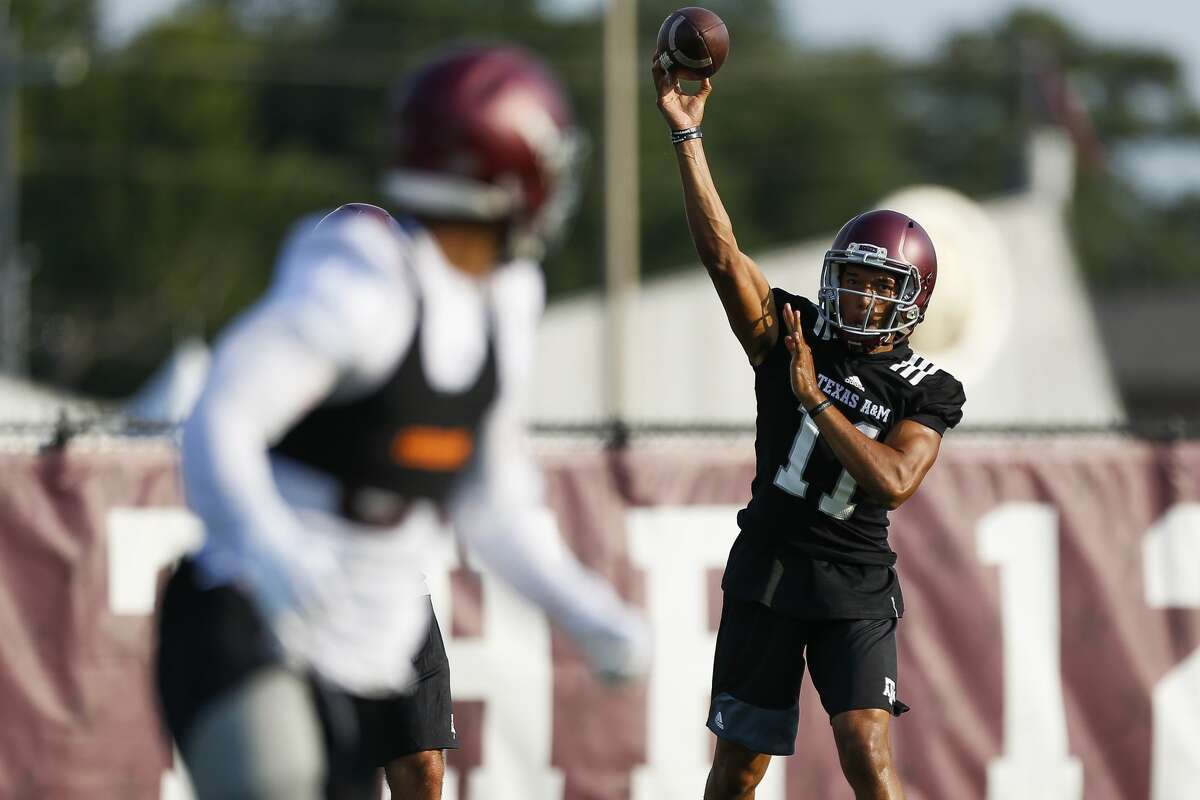 Texas A&M quarterback Kellen Mond throws a pass during the first day of football practice at the Coolidge Grass Practice Fields Friday, Aug. 4, 2017 in College Station. ( Michael Ciaglo / Houston Chronicle )