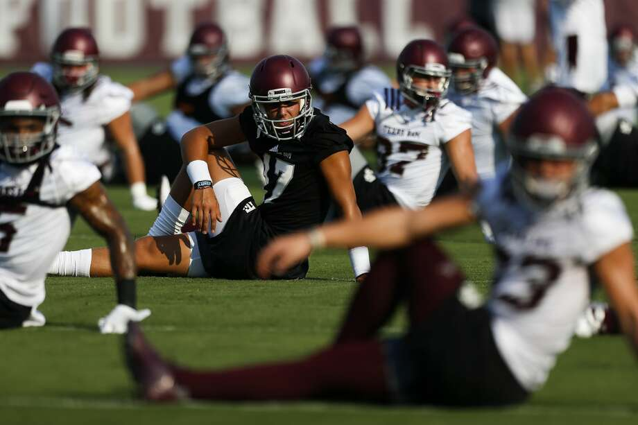 Texas A&M quarterback Nick Starkel, center left, stretches during the first day of football practice at the Coolidge Grass Practice Fields Friday, Aug. 4, 2017 in College Station. ( Michael Ciaglo / Houston Chronicle ) Photo: Michael Ciaglo/Houston Chronicle