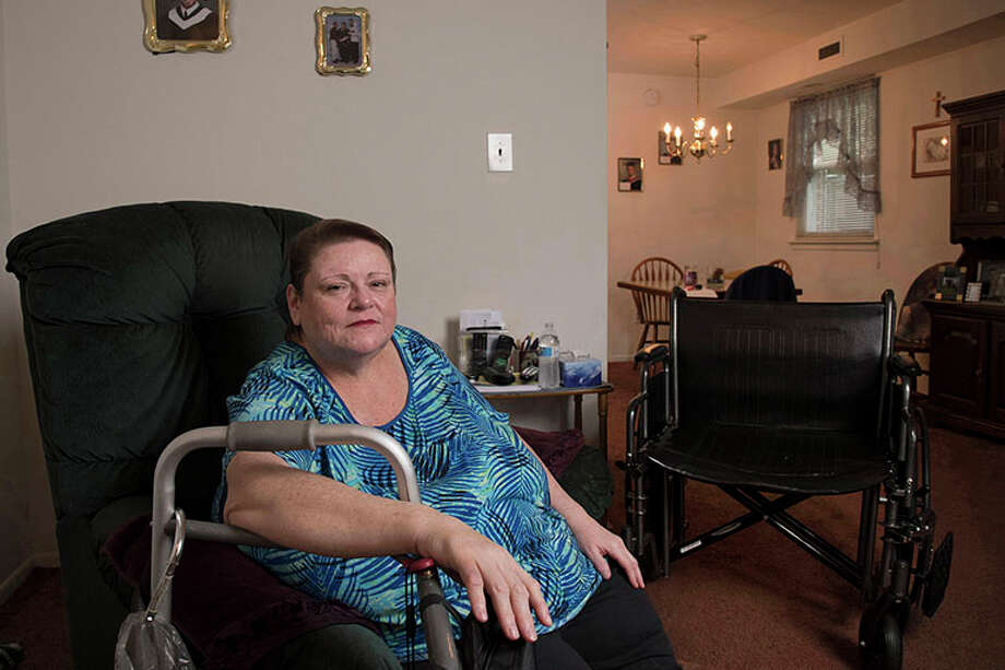 "Carol Emanuele of Philadelphia underwent two years of procedures for an open wound on her foot. ""I feel like a guinea pig,"" she said, referring to the dozens of treatments her doctors tried. Photo: Eileen Blass, HO / Kaiser Health News"