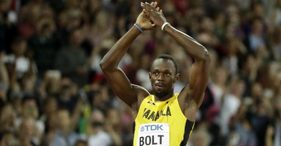 Jamaica's Usain Bolt greets his fans before a men's 100m heat during the World Athletics Championships in London Friday, Aug. 4, 2017. (AP Photo/Matt Dunham) Photo: Matt Dunham/Associated Press