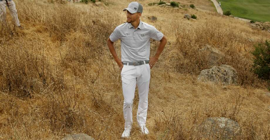 Stephen Curry looks over his options as he gets set to hit out of the rough on the eighth hole after pulling his drive during the second round of the Ellie Mae Classic golf tournament at TPC Stonebrae in Hayward, Ca., on Fri. August 4, 2017. Photo: Michael Macor/The Chronicle