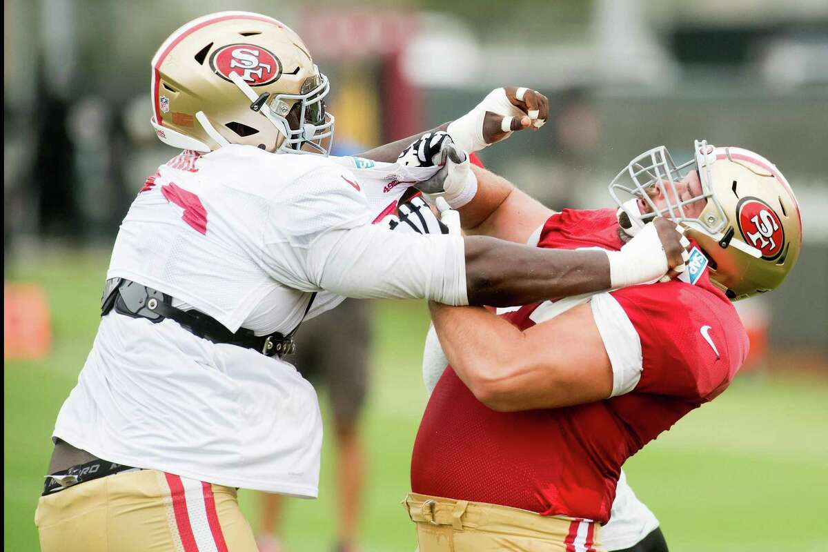 49ers defensive tackle Quinton Dial (left) and offensive lineman Tim Barnes engage in drills in Santa Clara. Dial started 11 games last year; Barnes spent the past five seasons with the Rams.