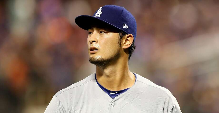 NEW YORK, NY - AUGUST 04:  Yu Darvish #21 of the Los Angeles Dodgers walks back to the dugout after the fourth inning against the New York Mets on August 4, 2017 at Citi Field in the Flushing neighborhood of the Queens borough of New York City.  (Photo by Elsa/Getty Images) Photo: Elsa/Getty Images